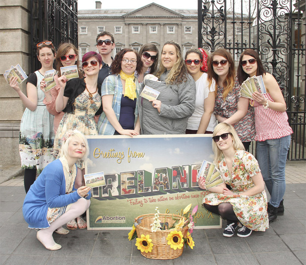 Members of the Abortion Rights Campaign dressed for the summer holidays launch a postcard campaign outside Leinster House, Dublin today (Wednesday 26th February 2013). The postcard campaign is part of 10 Days of Abortion Rights Action, starting on 1st March, calling on the Government to enact X-case legislation as promised and demanding that this happen before the Dáil breaks for summer holidays on 18th July. © William Hederman